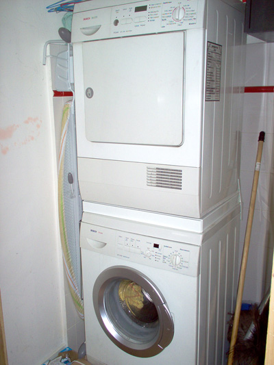 There ia a washing machine and a separate dryer.