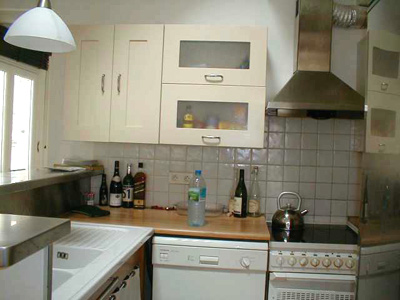 Paris apartment has a full kitchen with a dish washer, stove and oven