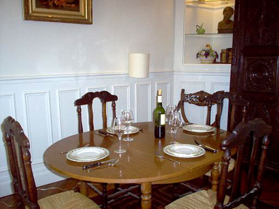 This Paris apartment has a charming dining area for great dinner parties.